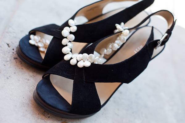 pearl necklace on black suede wedding shoes