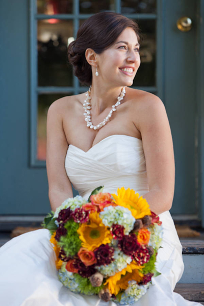 bride in strapless wedding gown and pearl necklace