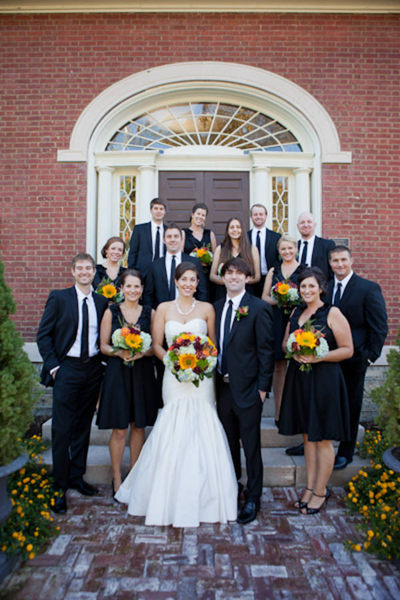bridal party wearing black in front of brownstone