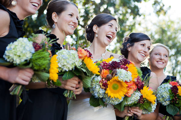 bridesmaids with mixed flower bouquets