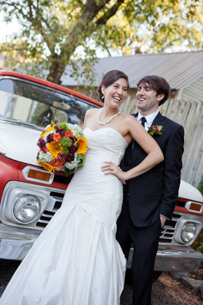 bride and groom portrait in front of vintage pick-up truck