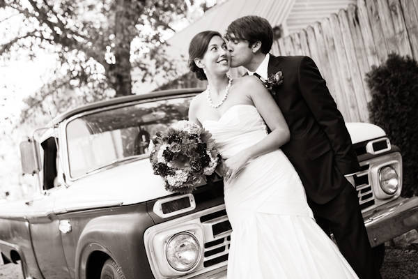 black and white couple portrait with vintage pick-up truck