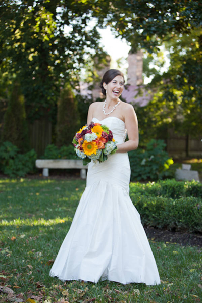 bride with large mixed flower bouquet