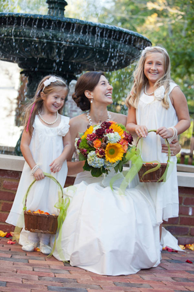 bride with flower girls wearing white dresses