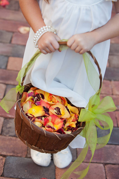 flower girl basket filled with rose petals
