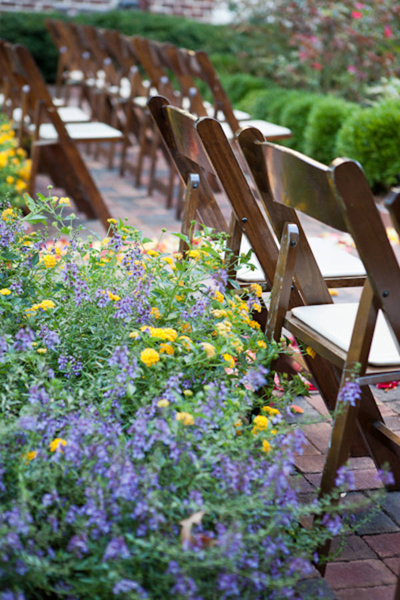 wooden folding chair at outdoor wedding reception