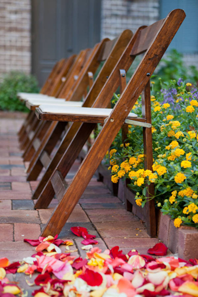 wooden folding chairs at outdoor wedding ceremony