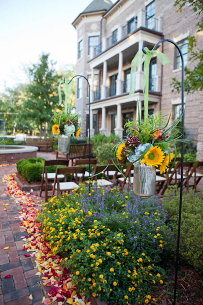 hanging flower arrangements at outdoor wedding ceremony