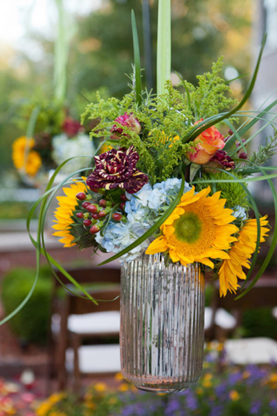 mixed flower flower arrangement in mercury glass vase