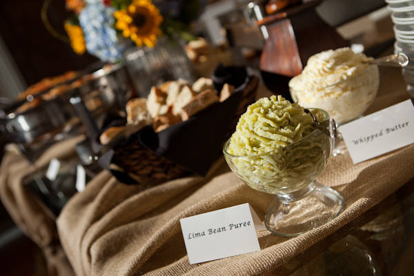wedding appetizers on burlap covered table