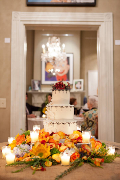 black and white wedding cake surrounded by orange flowers