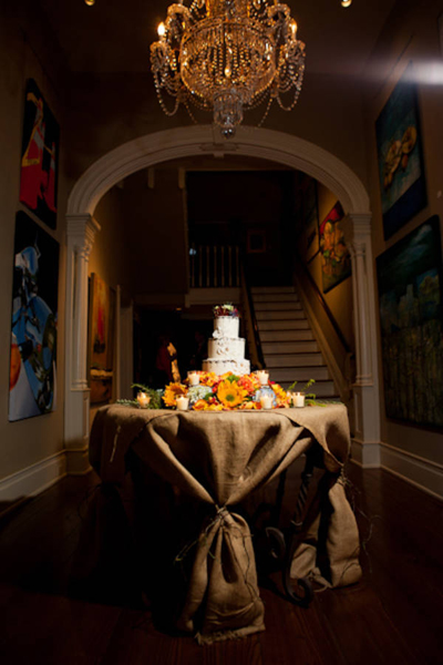 wedding cake beneath chandelier