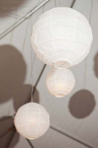 white paper lantern hanging in reception tent