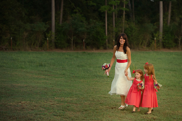 bride walking with flower girls