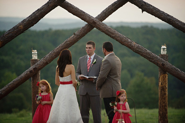 outdoor Arkansas wedding ceremony at dusk