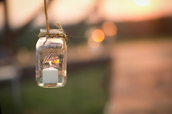 candle in hanging mason jar