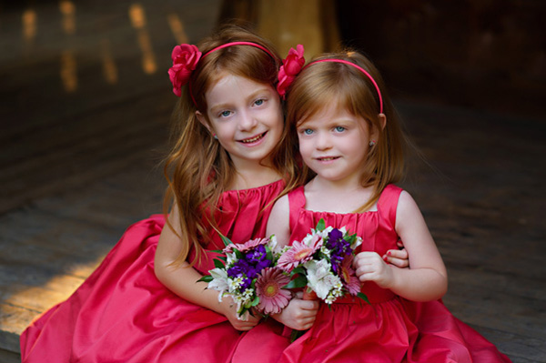 flower girls in red dresses