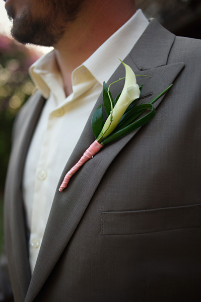 groom wearing lily boutonniere