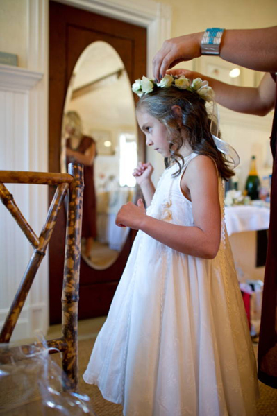 flower girl putting on flower crown