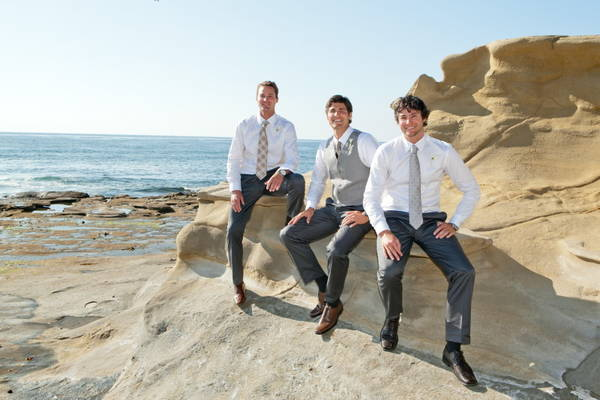 groomsmen by the ocean
