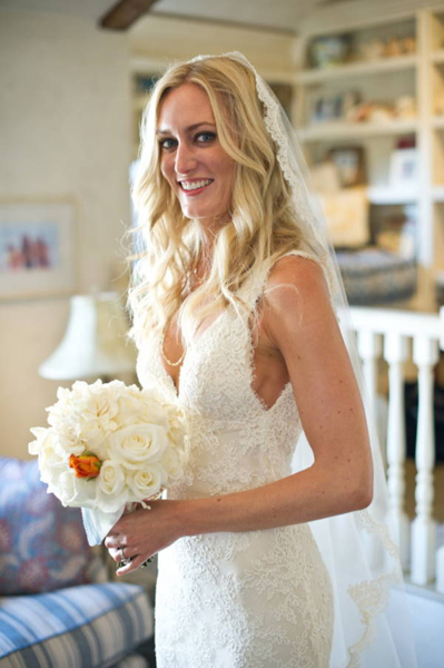 bride with all white rose bouquet