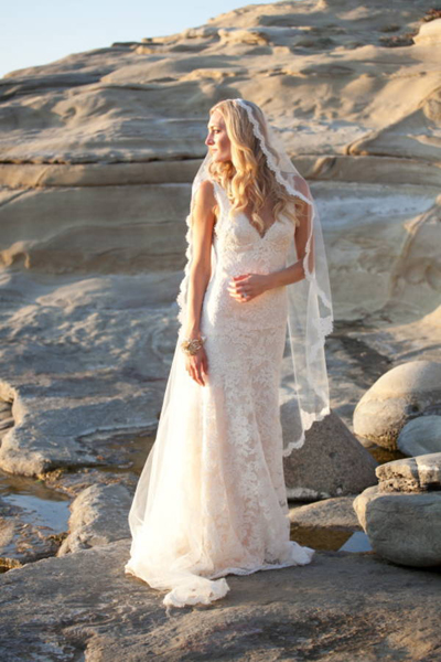 bride in lace wedding dress and lace trimmed cathedral veil