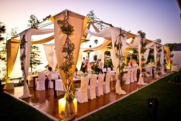 outdoor wedding reception tented with draped fabric
