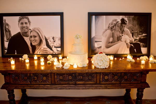 cake table with couple photos and candles