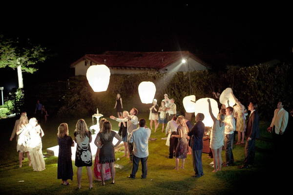 wedding guests releasing wish lanterns