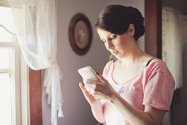 bride texting her groom
