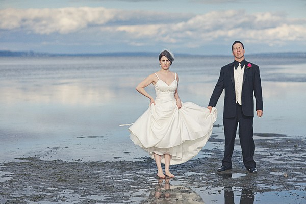 bride and groom on rock beach