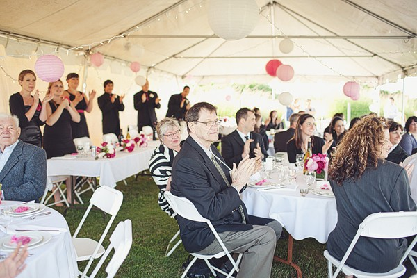 guests in wedding reception tent