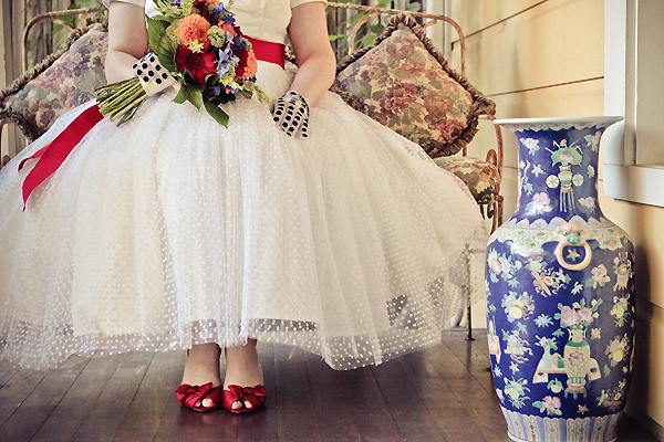 vintage bride wearing BHLDN dress and red shoes
