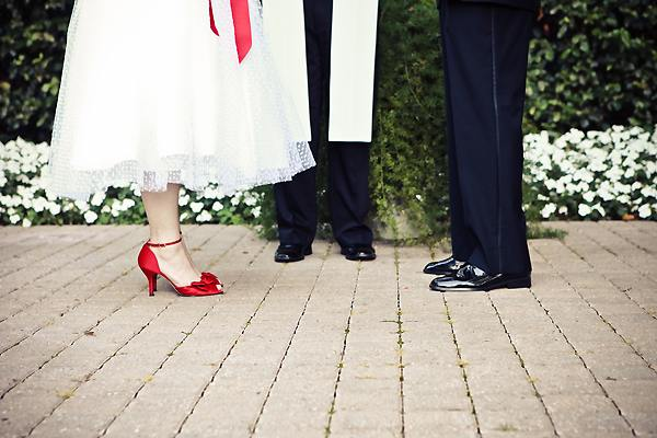 bride and groom's feet at the outdoor altar