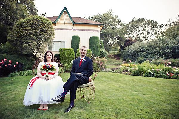 bride and groom sitting in the garden