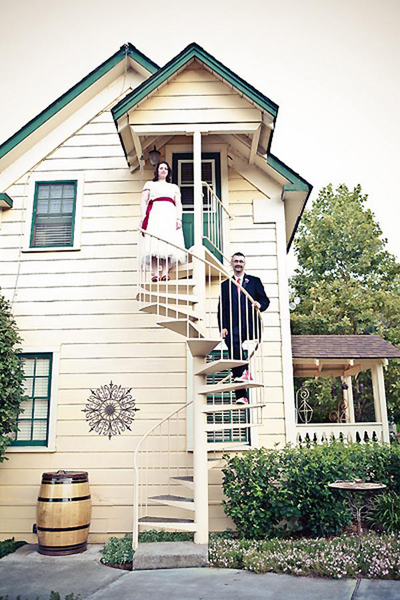bride and groom on spiral staircase