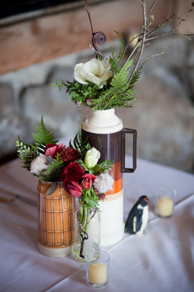flower arrangements in vintage thermoses