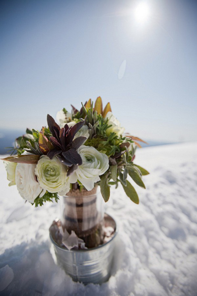 white ranunculus and succulent wedding bouquet