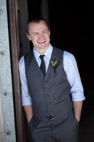 groom leaning in doorway