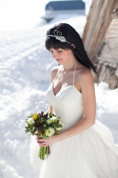 bride wearing short wedding dress in the snow