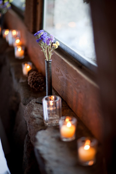 candles on stone window ledge