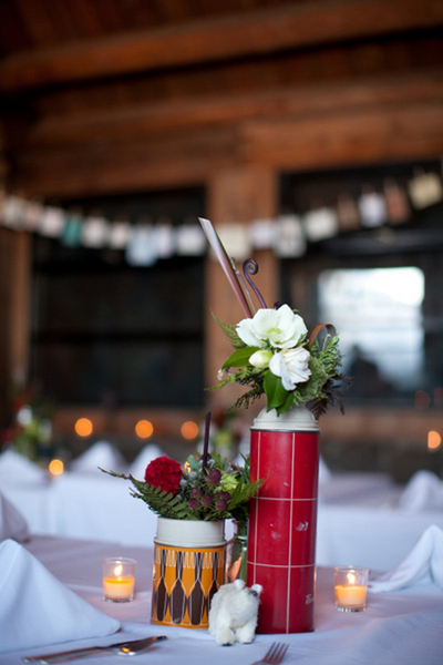 winter wedding flower arrangements in vintage thermoses