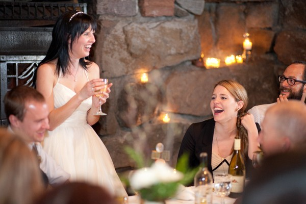 bride laughing during her speech
