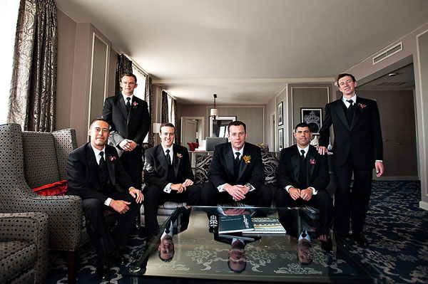 groomsmen in hotel suite