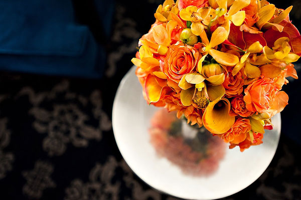 orange rose, lily, and orchid wedding bouquet