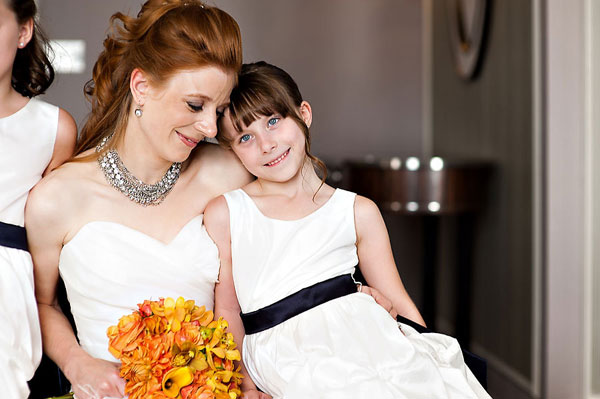 bride and flower girl in white dress