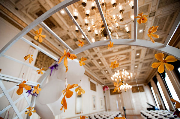 orange orchids hanging at the altar