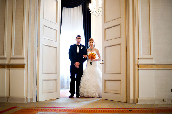 bride in doorway of ballroom