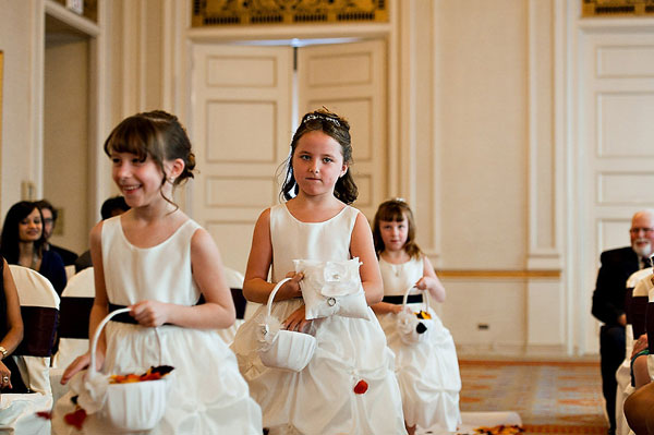 flower girls in white and black dresses