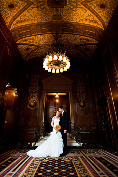 bride and groom in grand lobby